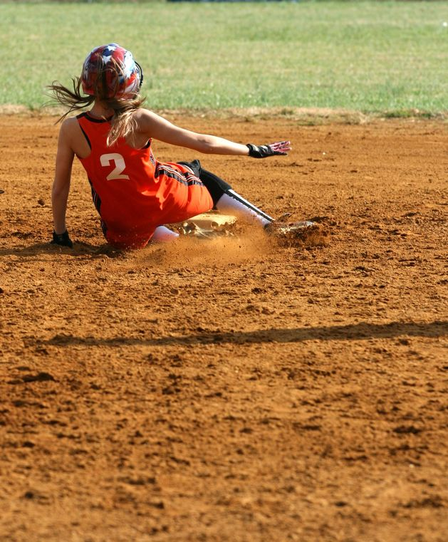 3596266 – a fastpitch softball player sliding into second base